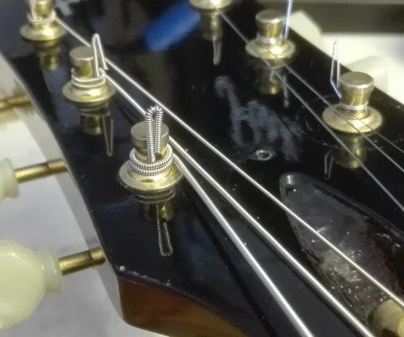 Upward view of a stringed headstock