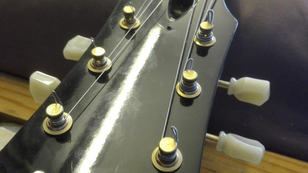 Downward view of a stringed guitar